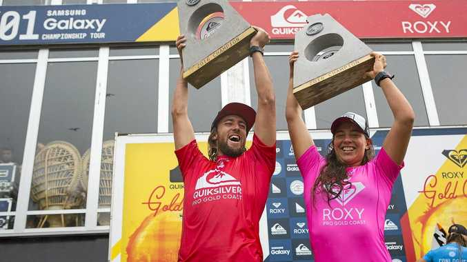 Byron Bay-based Matt Wilkinson and former Lennox Head surfer Tyler Wright celebrate after winning the Quiksilver and Roxy pros at Snapper Rocks on the Gold Coast.
