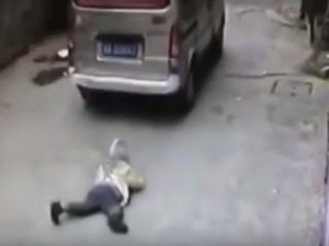 Warning: disturbing footage. Boy run over by van