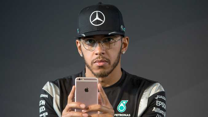 Lewis Hamilton is being investigated by police after publishing footage of himself using a cellphone while driving a motorbike. Photo: EPA