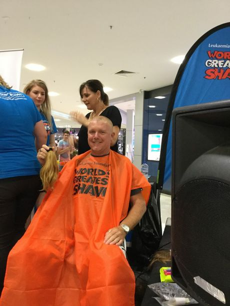 Clinton Butler grew his hair for three years in order to have it made into a wig for a little girl with cancer, he shaved it off and raised money in the World's Greatest Shave. Photo: contributed