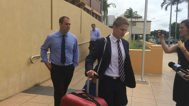 Former police officer Trent Christopher Birthisel (left) has been found not guilty on all counts of raping a 20-year-old woman. In the background is his defence barrister Stephen Zillman and on the right is solicitor Callan Lloyd. Photo Lucy Smith / Daily Mercury