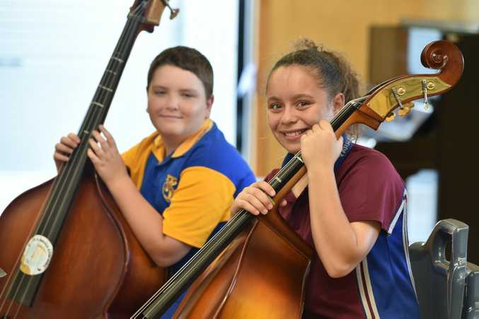 Torquay's Rhylie Honor and Yarliee's Nadia Fogarty ready to make music on the double bass. With so much young talent on the Fraser Coast, turning Maryborough into a music capital should be easy.