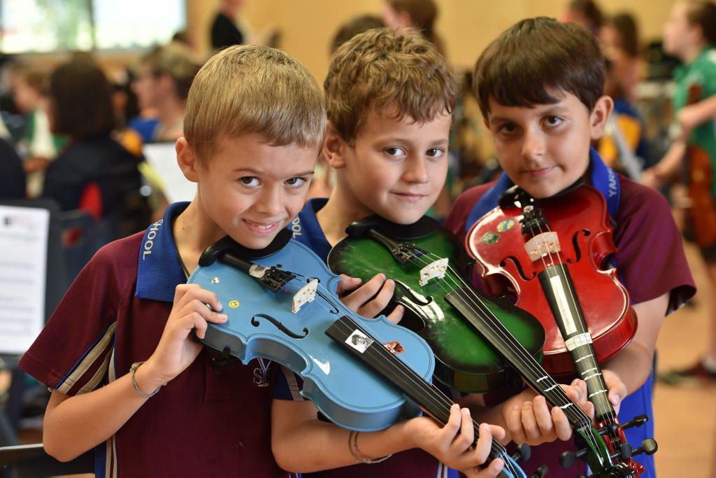 Primary school beginner strings workshop at Kawungan State School - (L) Brody Gillespie, Art Risoz and Riley Denton from Yarrilee State School. Photo: Alistair Brightman / Fraser Coast Chronicle