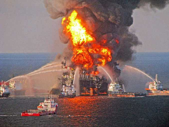 APRIL 22, 2010: Fire-fighting vessels try to extinguish the blaze on BP's Deepwater Horizon oil drilling unit in the Gulf of Mexico.