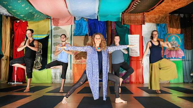 Yoga instructor Lila Kirtana leads students Robert Ricketts, Mal Nice, and Henrike Schreer at the Hare Krishna Village.
