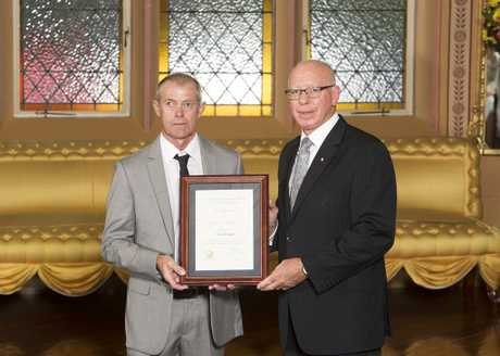 Tony Brindle is presented with his award from the NSW governor. Photo courtesy of Rob Tuckwell Photography