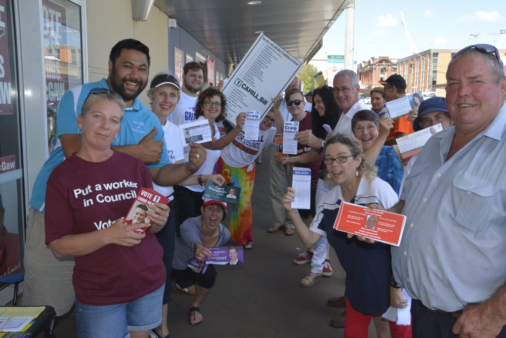 Candidates and their supporters hand out how to vote cards outside the Electoral Commission Queensland office in Ruthven St. Photo Andrew Backhouse / The Chronicle
