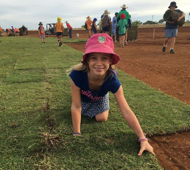 HOME TURF: Felicity York is all smiles after she turned out to lay turf at the Rolleston Community Oval earlier this month.