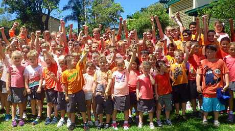 HANDS UP: Yeppoon State School students put their hands up to say