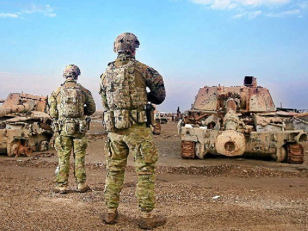 TAKING CARE: Diggers Brandon James, from Mooroopna, Victoria, and Corren Ints, from Morayfield, Queensland, secure a tank graveyard outside an Australian camp in Iraq earlier this year.