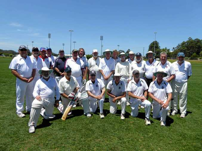 YOUNG AT HEART: Coffs Harbour and Hastings Valley golden oldie cricketers wait for the umpire's call for play to begin.