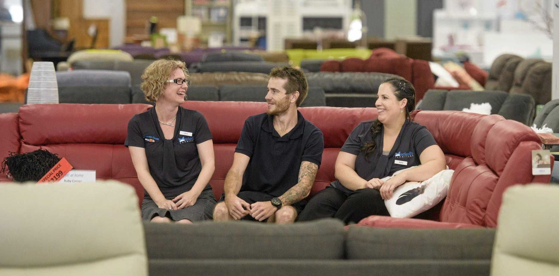 SITTING PRETTY: Area manager Lara Richards with Mathew Hamilton and Kylie Roper at MacLeods furniture in Grafton.