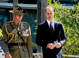 The Duke of Cambridge speaks with General David Hurley, AC, DSC, as the Royal couple depart the Officers' Mess at RAAF Base Amberley on Saturday, April 19. Photo: Claudia Baxter / The Queensland Times