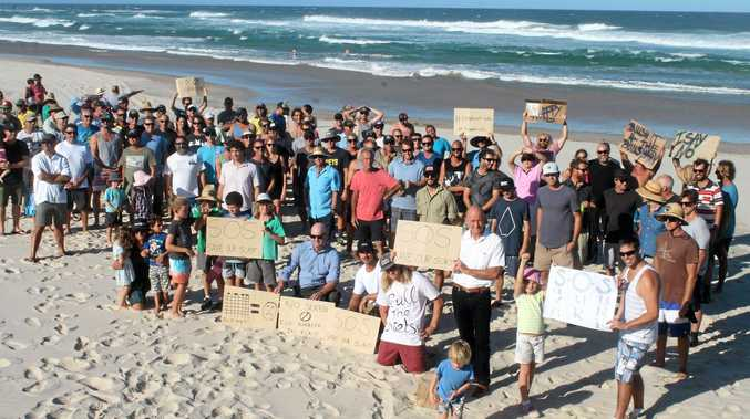 About 200 people attended a protest on Friday, March 18, about the positioning of the planned Shark Eco-Barrier at Lighthouse Beach.
