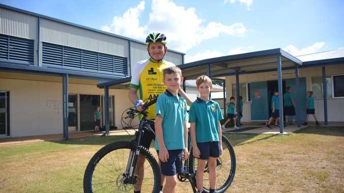 FOOT TO PEDAL: Jason Wyeth with Kingaroy State School Students Harrison Braithwaite and Riley Morgan.