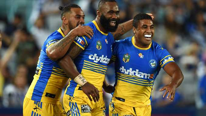 Man of the moment ... Semi Radradra celebrates with teammates. Photo: AAP Image.