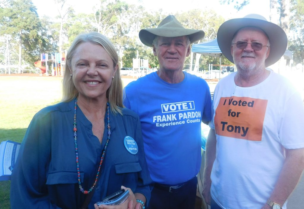 Tewantin polling for Noosa Council with mayoral candidate Sandy Bolton, ccouncillor candidate Frank Pardon and outgoing Mayor Noel Playford working the crowd.