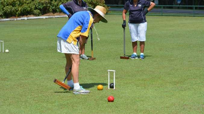 FULL FOCUS: Gladstone Croquet Club's Karen Waltham said three different forms of the sport was on show yesterday. Photo Nick Kossatch / Observer