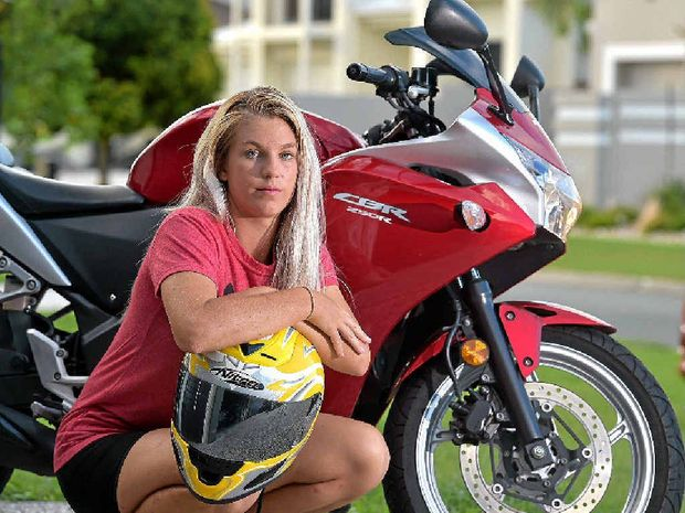 NOT ME: Someone has copied the number plate of Cassie Lewis's motorbike and she has been sent traffic fines that she is not responsible for.