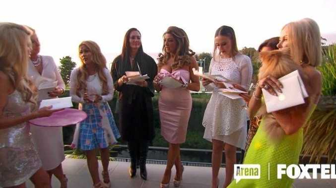 The Real Housewives of Melbourne star Gamble Breaux presents the rival housewives with their invites to her Byron Bay wedding.