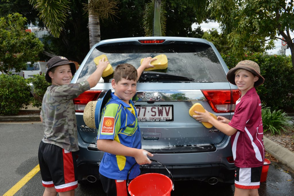 Making light work of car cleaning is the many hands of from left, Ethan Cocco, Hudson Camilleri and Coby Rodwell. Photo Peter Holt / Daily Mercury