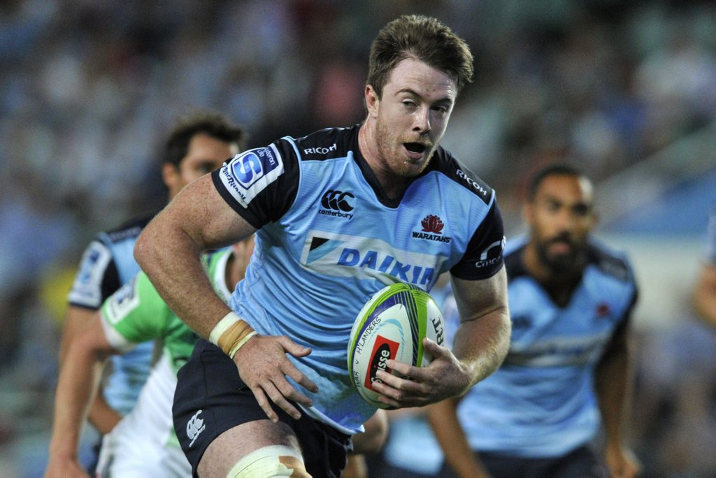 Jed Holloway of the Waratahs runs with the ball during the Round 4 Super Rugby match between the NSW Waratahs and the Highlanders at Allianz Stadium in Sydney, Friday, March 18, 2016. (AAP Image/Joel Carrett) NO ARCHIVING, EDITORIAL USE ONLY
