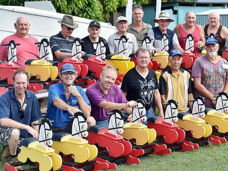 TOY CAVALRY: Hervey Bay Men's Shed members with some of the 20 rocking horses.