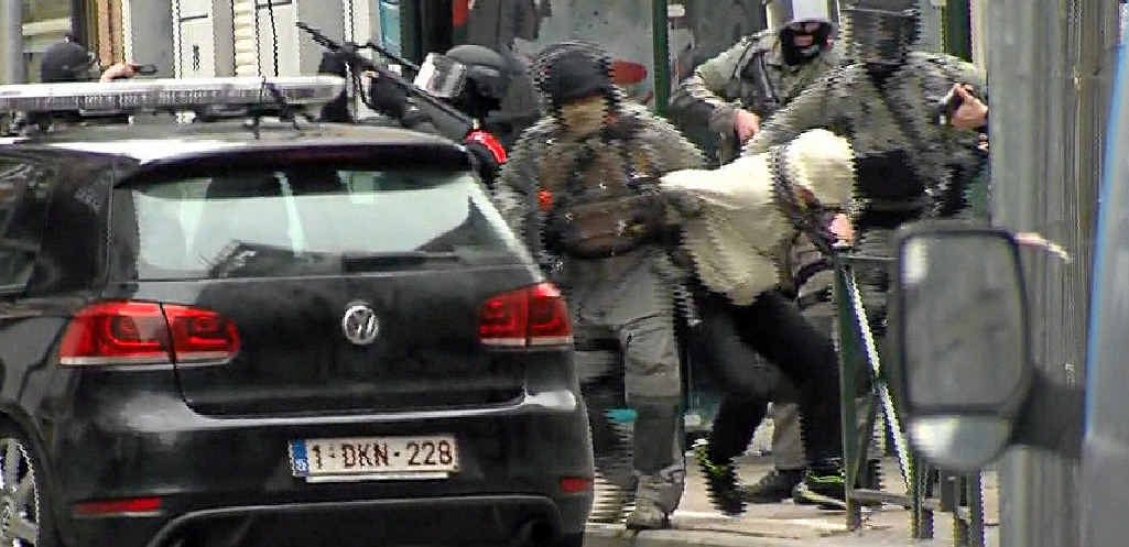 GOTCHA: Suspected terrorist Salah Abdeslam is dragged to a waiting police car in Brussels on Friday.