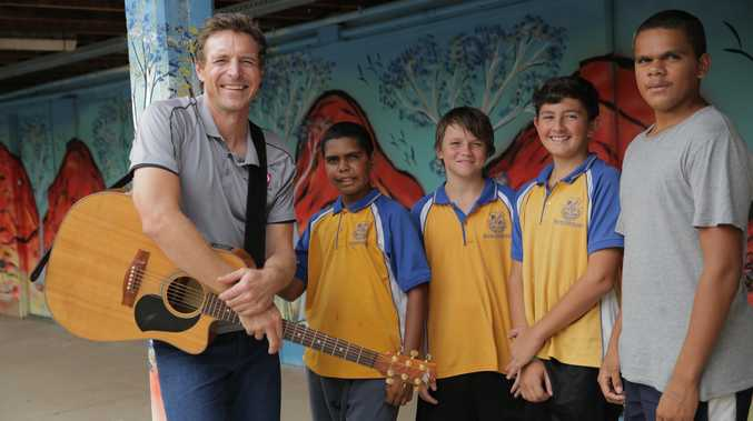 Josh Arnold works with students Clinton, Julian, Hayden and Bradley from Baralaba State School.