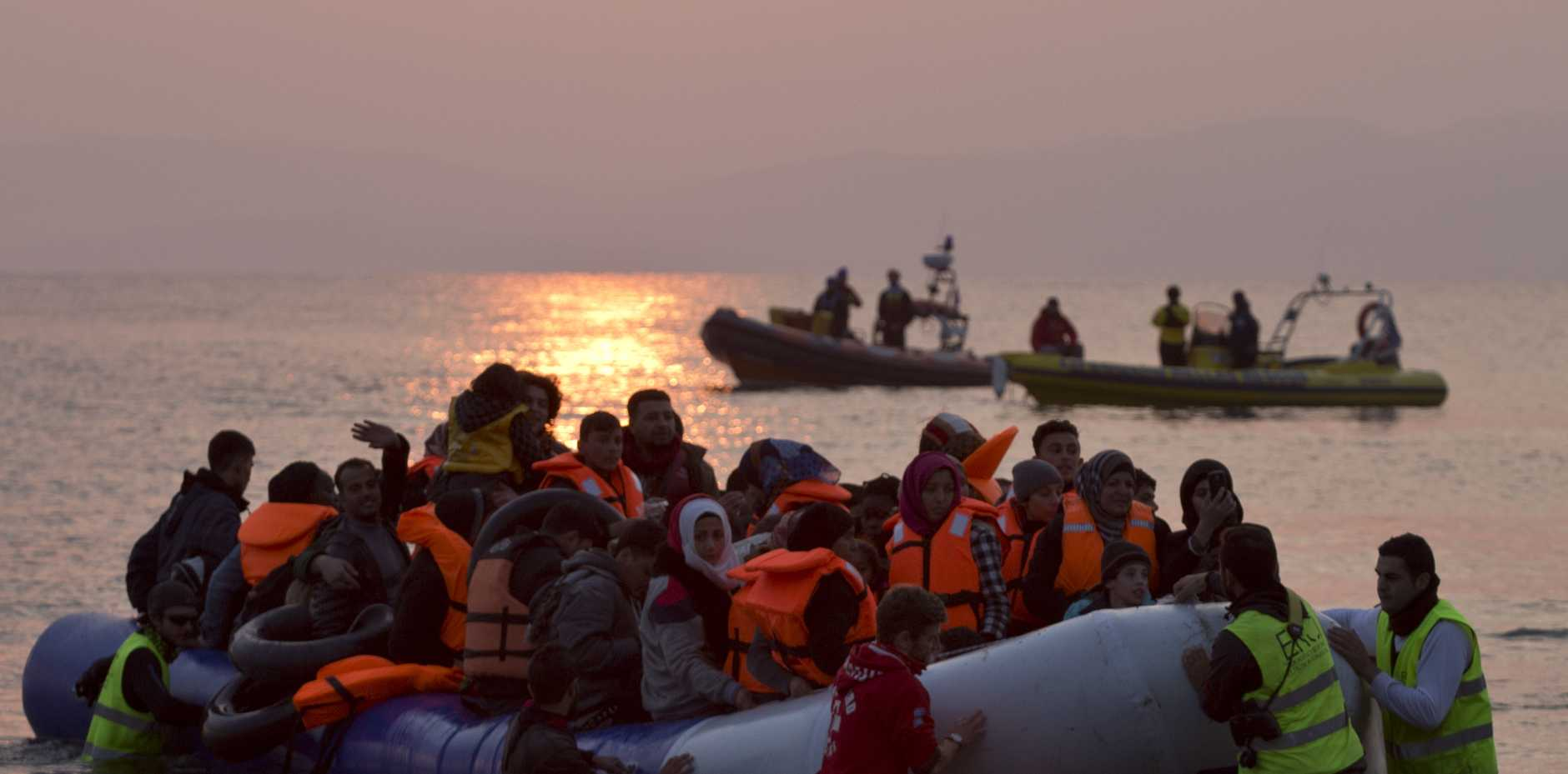 Migrants and refugees arriving on Lesbos yesterday despite the deal; there were two fatalities. Photo: AP