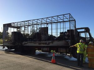 Burnt out removalist truck reignites during salvage mission