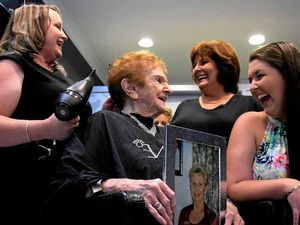 Hairdresser styles hair of four generations