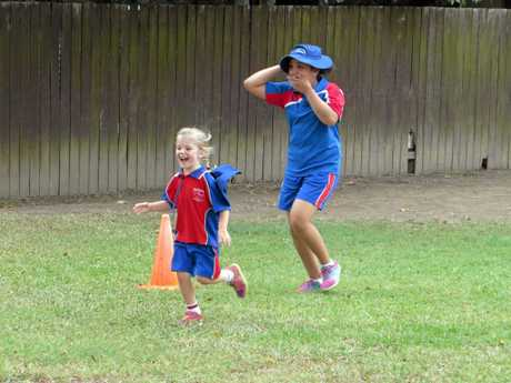 Running with a buddy at St Mary's Primary Grafton Cross Country.