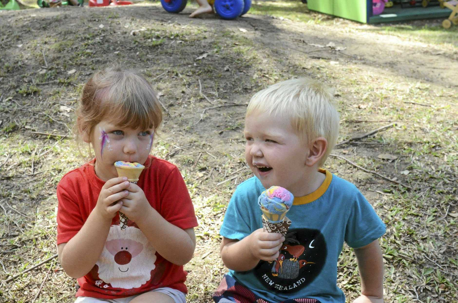YUM: Lara Clydsedale, 4, and Edward Huntley, 3, enjoy their ice cream at the Clarence Valley's Big Playgroup Day, Monday March 21.