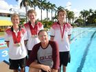MEDAL HAUL: Coach Paul Simms talks about a successful meet at the State Secondary Schools Competition in Brisbane and medal hauls from swimmers such as Macson Cottle, Jordan Smith and Connor Simms. Photo: Max Fleet / NewsMail