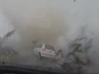 Dash Cam vision as a tornado sweeps over a car in Taiwan.