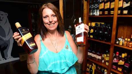 RUM FAN: South Kolan resident Michelle Kelly is an avid collector of Bundaberg Rum memorabilia. Photo: Max Fleet / NewsMail