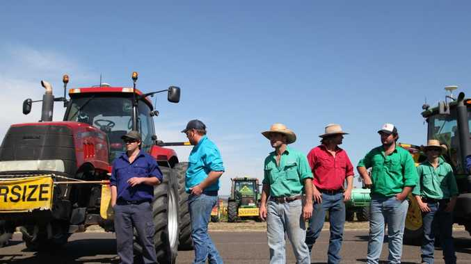 AUSTRALIA, Liverpool Plains: Protesting farmers form a line in front of their tractors in Breeza on August 21, 2015 to protest Shenhua's plans to build a coal mine. The $1.2 billion Watermark coal mine, to be built by the Chinese state-owned company, was given Federal approval in early July of this year, causing controversy (AAP Image/NEWZULU/KATE AUSBURN). NO ARCHIVING, CROWD SOURCED CONTENT, EDITORIAL USE ONLY
