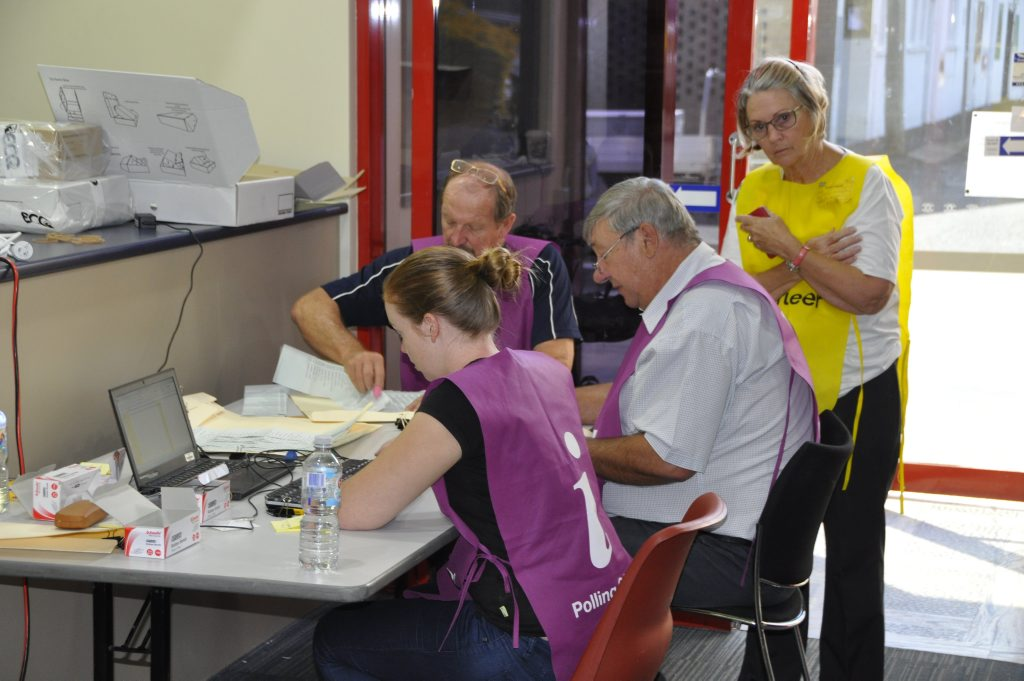 ECQ officials counting votes. Photo Andrew Backhouse / The Chronicle