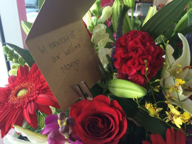 Customers left flowers at Terry White Chemists Little Mountain in honour of late owner Margo Kliendienst.