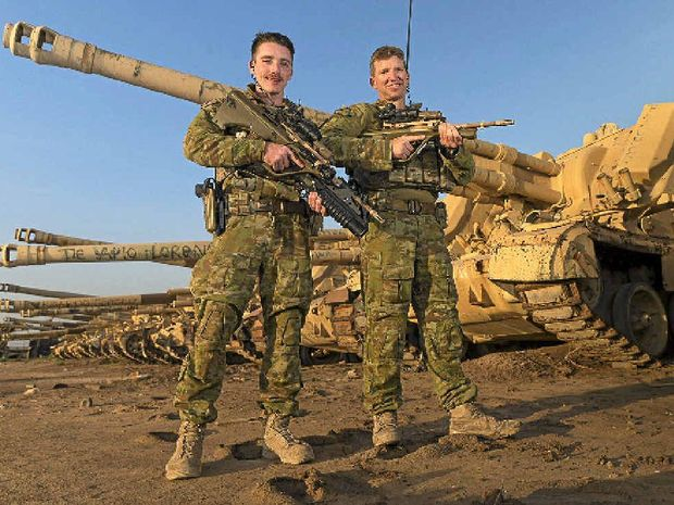 ON TOUR: Gladstone diggers Private Alex Ogilvie and Company Sergeant Major John Craig in Iraq for Task Group Taji.