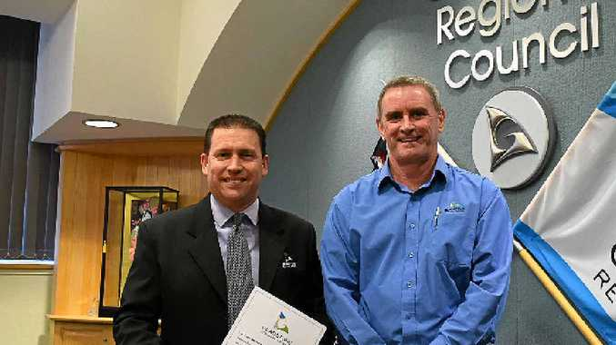 IT'S OFFICIAL: Matt Burnett was sworn is as Gladstone Regional Council mayor yesterday by chief executive officer Stuart Randle.