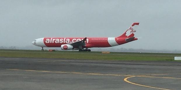 AirAsia X A330-300 lands at Auckland International Airport.