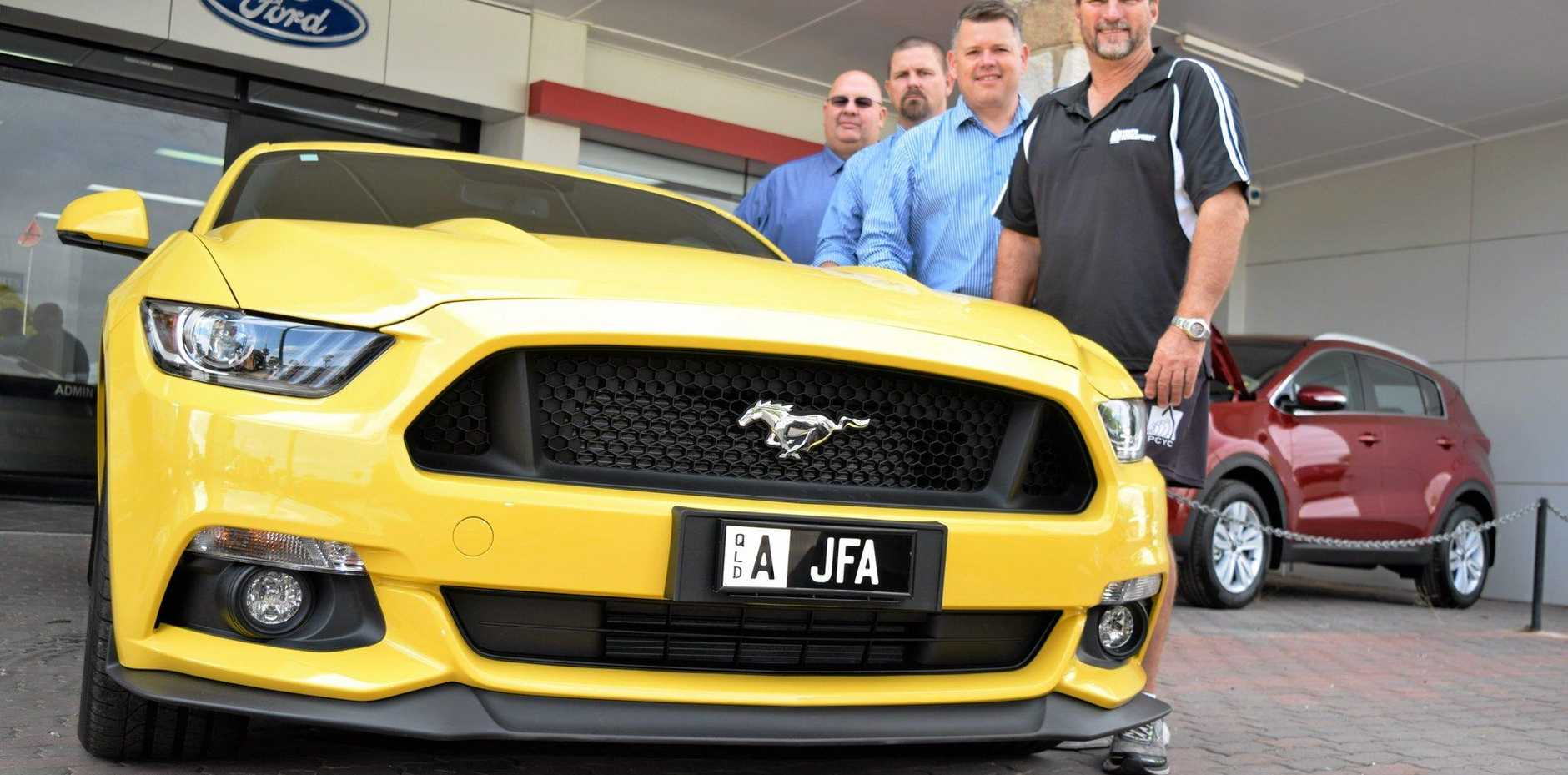 MUSTANG: (From left) Ross Nicholas, Ivan Maunder, John Armstrong and Greg Caletti with the prized Mustang for Easter in the Country.