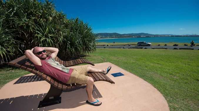 Irishman Ed Swan enjoys the street furniture recently installed on the Wayne Glenn Rotary walk on the south side of the Harbour.. 23 March 2016. Photo: Trevor Veale / The Coffs Coast Advocate