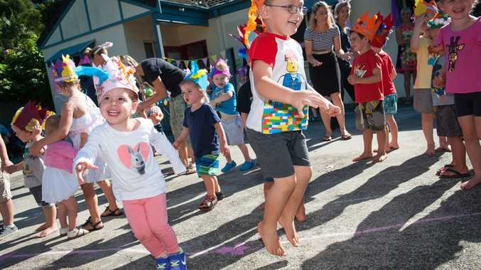 Pre-schoolers Samatha and Joshua hop into Easter during the hat parade at Little Hands pre-school and long day care at Boambee East. Photo: Trevor Veale/Coffs Coast Advocate