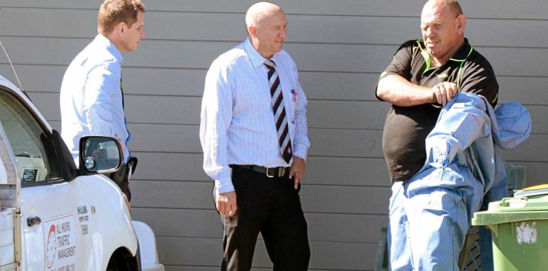 Murder accused Kenneth John Beattie (right) outside the Scottsdale St address.