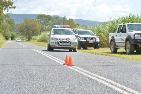 Police investigating the helicopter crash site at Jackon's Crossing Rd in Carmila, south of Mackay. Photo Tony Martin / Daily Mercury