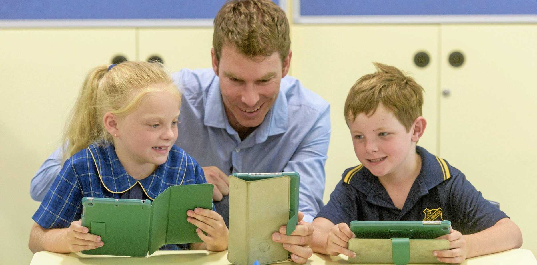 ACCELERATED LEARNING: South Grafton Public School students Aila Giggins and Toby Tibbett and teacher Brendan Taylor learning with their iPads.
