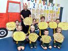 RUNNERS: Andrea Hamilton is given a load of hay bales by students (back row, from left) Olivia Frawley, Isabelle Barnes, Cooper Macdonald and Sam Stoneley, (front row) Matilda Tate, Nathan Mills, Patrick Murphy and Grace Toplis.